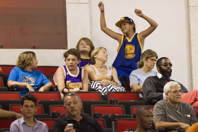 A fan dances to the music during the NBA Summer League game between the Boston Celtics and the Dallas Mavericks at the Cox Pavilion on Tuesday, July 12, 2016, in Las Vegas. Erik Verduzco/Las Vegas ...