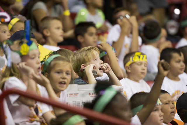 Caden Atwood, 8, center, watches a NBA Summer League  game between the Utah Jazz and the Portland Trail Blazers at the Thomas and Mack Center on Tuesday, July 12, 2016, in Las Vegas.