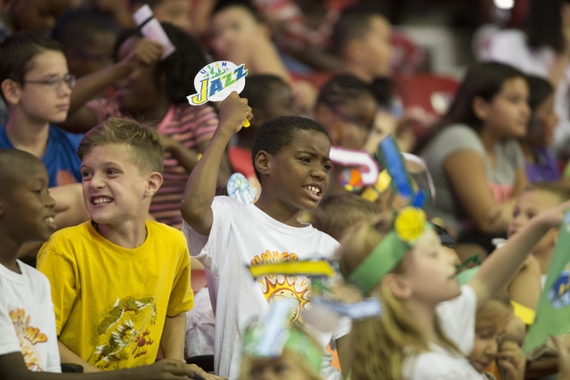 Jace Cash, 8, center, watches a NBA Summer League  game between the Utah Jazz and the Portland Trail Blazers at the Thomas and Mack Center on Tuesday, July 12, 2016, in Las Vegas.