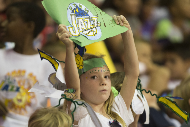 Jane Campbell, 8, center, watches a NBA Summer League game between the Utah Jazz and the Portland Trail Blazers at the Thomas and Mack Center on Tuesday, July 12, 2016, in Las Vegas.