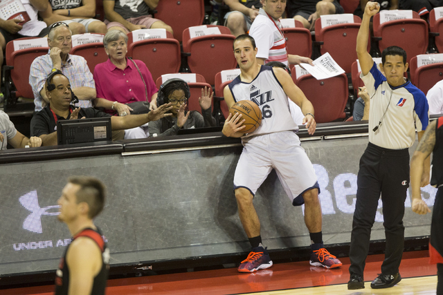 Utah Jazz Aaron Craft (36) is fouled against the Portland Trail Blazers during the NBA Summer League game at the Thomas and Mack Center on Tuesday, July 12, 2016, in Las Vegas. The Trail Blazers w ...