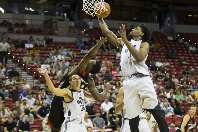 Utah Jazz Quincy Ford (17) secures a rebound against the Portland Trail Blazers during a NBA Summer League game at the Thomas and Mack Center on Tuesday, July 12, 2016, in Las Vegas. The Trail Bla ...