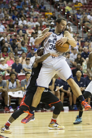 Utah Jazz Aaron Craft (36) secures a rebound against the Portland Trail Blazers during a NBA Summer League game at the Thomas and Mack Center on Tuesday, July 12, 2016, in Las Vegas. The Trail Bla ...