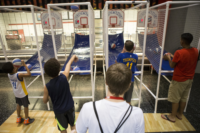 Children shoot baskets during the NBA Summer League tournament at the Thomas and Mack Center on Tuesday, July 12, 2016, in Las Vegas. (Erik Verduzco/Las Vegas Review-Journal) Follow @Erik_Verduzco