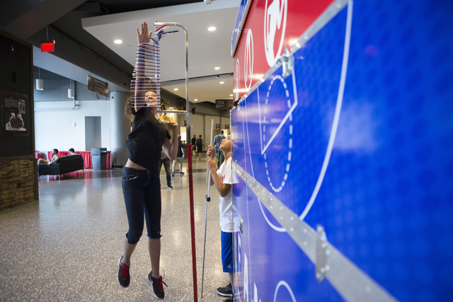 Tashaya Rothmeyer, 13, takes a leap to record her vertical jump during the NBA Summer League tournament at the Thomas and Mack Center on Tuesday, July 12, 2016, in Las Vegas. Erik Verduzco/Las Veg ...