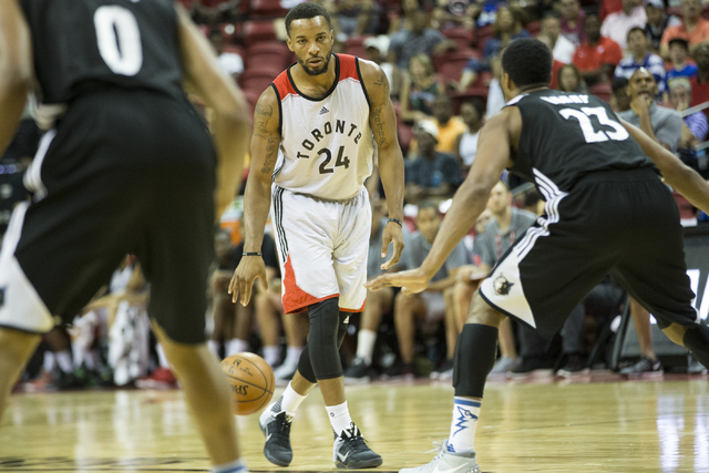 Toronto RaptorsՠNorman Powell (24) dribbles the ball on offense against the Minnesota Timberwolves in the NBA Summer League quarterfinal game at the Thomas & Mack Center on Saturday, July 16, ...