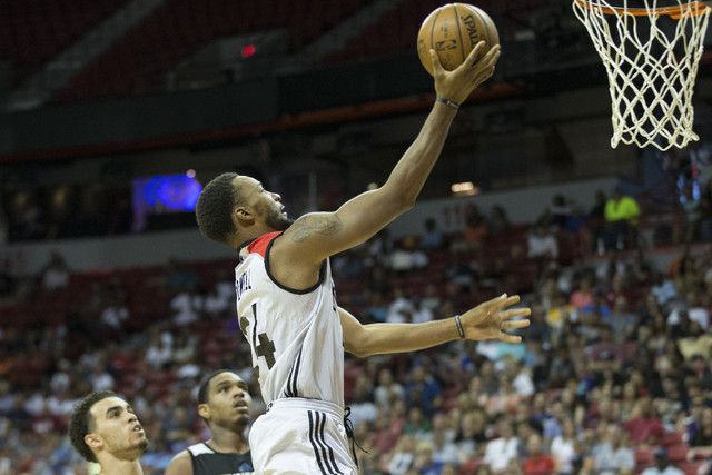 Toronto RaptorsՠNorman Powell (24) goes up for a lay-up against the Minnesota Timberwolves in the NBA Summer League quarterfinal game at the Thomas & Mack Center on Saturday, July 16, 2016, i ...