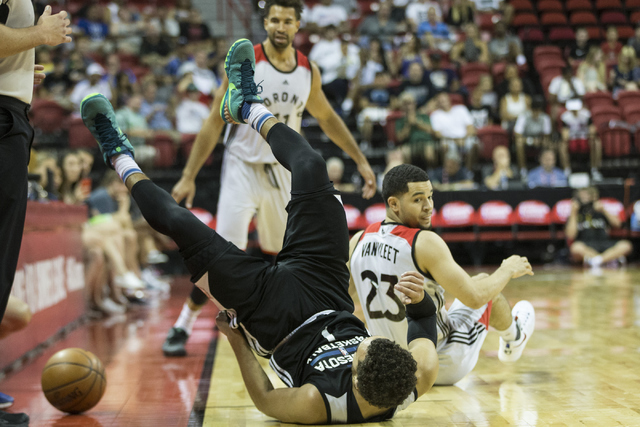 Minnesota TimberwolvesՠTyus Jones (1) takes a fall against the Toronto Raptors in the NBA Summer League quarterfinal game at the Thomas & Mack Center on Saturday, July 16, 2016, in Las Vegas. ...