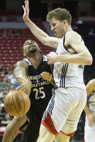 Minnesota TimberwolvesՠXavier Silas (25) is fouled by Toronto RaptorsՠJakob Poeltl (42) in the NBA Summer League quarterfinal game at the Thomas & Mack Center on Saturday, July 16, 2016, in  ...
