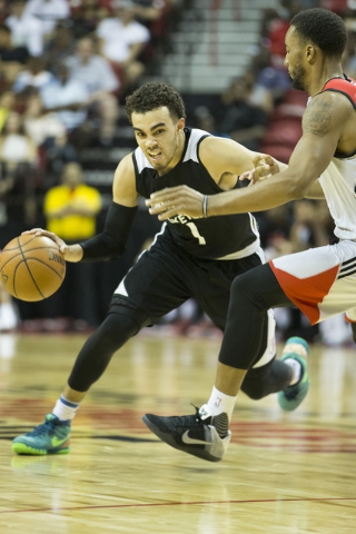 Minnesota TimberwolvesՠTyus Jones (1) dribbles the ball to the hoop against the Toronto Raptors in the NBA Summer League quarterfinal game at the Thomas & Mack Center on Saturday, July 16, 20 ...