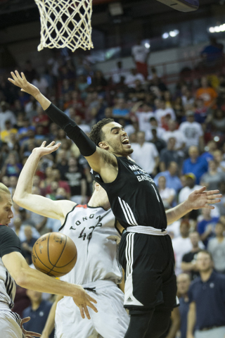Minnesota TimberwolvesՠTyus Jones (1) is stripped from the ball against the Toronto Raptors in the NBA Summer League quarterfinal game at the Thomas & Mack Center on Saturday, July 16, 2016,  ...