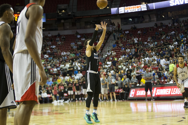 Minnesota TimberwolvesՠTyus Jones (1) shoots to a free throw to score the last point of the game against the Toronto Raptors in the NBA Summer League quarterfinal game at the Thomas & Mack Ce ...