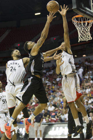 Minnesota Timberwolves' Xavier Silas (25) goes up for a shot against the Toronto Raptors in the NBA Summer League quarterfinal game at the Thomas & Mack Center on Saturday, July 16, 2016, in ...