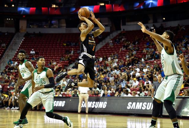 Phoenix guard Tyler Ulis (8) shoots over Boston during an NBA summer league basketball game at the Thomas & Mack Center Sunday, July 10, 2016, in Las Vegas. (David Becker/Las Vegas Review-Jour ...