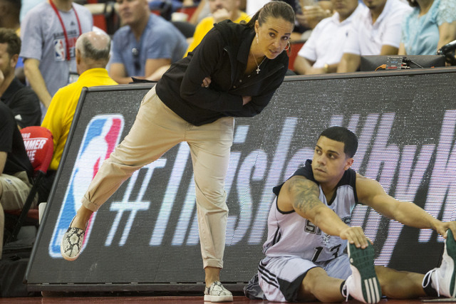 Becky Hammon, left, summer head basketball coach for the San Antonio Spurs, speaks with Angel Rodriguez (13), in their NBA Summer League game against the Sacramento Kings at the Cox Pavilion on Fr ...