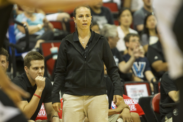 Becky Hammon, summer head basketball coach for the San Antonio Spurs, watches her team play against the Sacramento Kings in the NBA Summer League game at the Cox Pavilion on Friday, July 15, 2016, ...