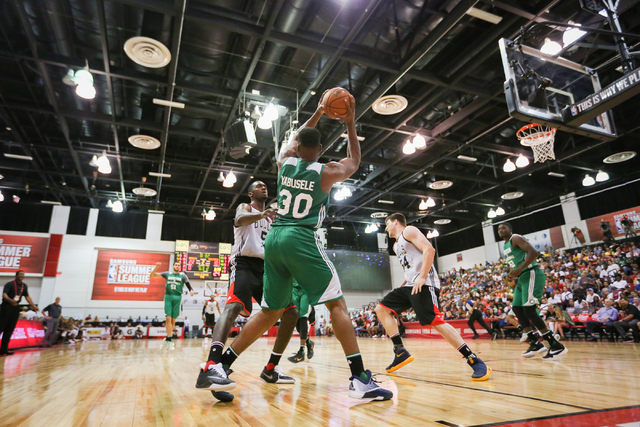 Guerschon Yabusele (30) of the Boston Celtics looks for an open man while being double teamed by Chicago Bulls defenders during an NBA Summer League game at the Cox Pavilion in Las Vegas on Saturd ...