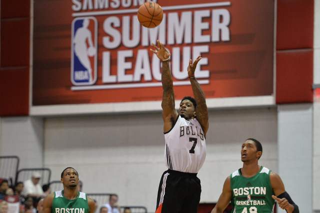 Patrick Miller (7) of the Chicago Bulls takes a half-court shot at the end of the first half during an NBA Summer League game against the Boston Celtics at the Cox Pavilion in Las Vegas on Saturda ...
