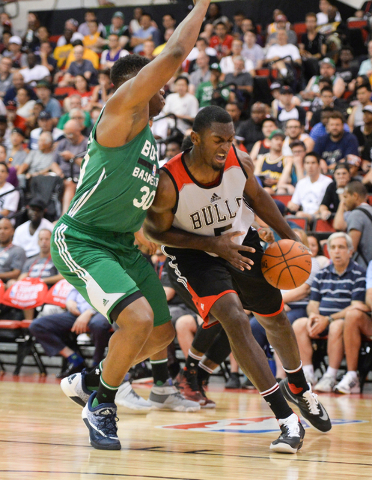 Bobby Portis (5), of the Chicago Bulls, drives the ball around Guerschon Yabusele (30), of the Boston Celtics, during an NBA Summer League game at the Cox Pavilion in Las Vegas on Saturday, July 9 ...