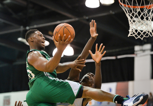 Guerschon Yabusele (30), of the Boston Celtics, shoots the ball over Bobby Portis (5), of the Chicago Bulls, during an NBA Summer League game at the Cox Pavilion in Las Vegas on Saturday, July 9,  ...