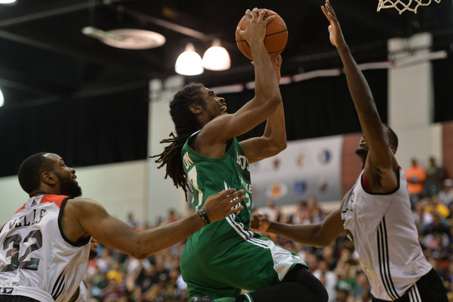 Marcus Thornton (27), of the Boston Celtics, shoots the ball over Chicago Bulls defenders during an NBA Summer League game at the Cox Pavilion in Las Vegas on Saturday, July 9, 2016. (Brett Le Bla ...