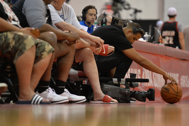 A camera man positions a basketball during an NBA Summer League game between the Boston Celtics and the Chicago Bulls at the Cox Pavilion in Las Vegas on Saturday, July 9, 2016. (Brett Le Blanc/La ...