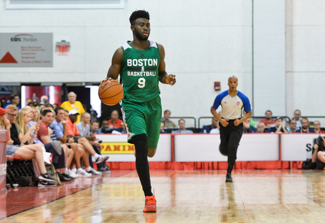 Jaylen Brown (9), of the Boston Celtics, dribbles the ball down the court during an NBA Summer League game against the Chicago Bulls at the Cox Pavilion in Las Vegas on Saturday, July 9, 2016. (Br ...
