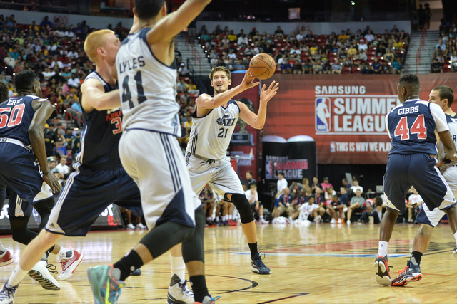 Tibor Pleiss (21), of the Utah Jazz, passes the ball during an NBA Summer League game against the Washington Wizards at the Thomas & Mack Center in Las Vegas on Saturday, July 9, 2016. (Brett  ...
