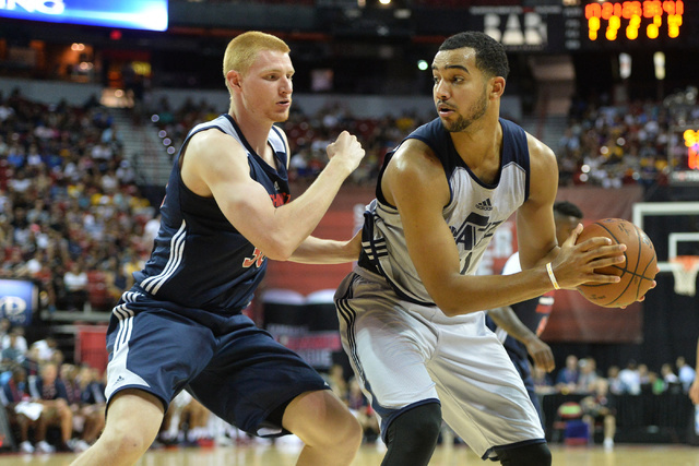 Aaron White (30), of the Washington Wizards, guards Trey Lyles (41), of the Utah Jazz, during an NBA Summer League game at the Thomas & Mack Center in Las Vegas on Saturday, July 9, 2016. (Bre ...