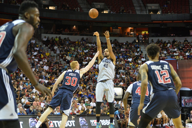 Trey Lyles (41), of the Utah Jazz, takes a shot over Aaron White (30), of the Washington Wizards during an NBA Summer League game at the Thomas & Mack Center in Las Vegas on Saturday, July 9,  ...
