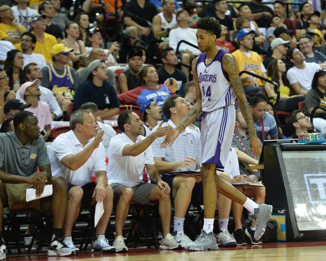 Los Angeles forward Brandon Ingram (14) high fives coaches after being substituted out of an NBA Summer League game against the Philadelphia 76ers at the Thomas & Mack Center in Las Vegas on S ...