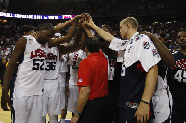 The entire team huddles together after Paul George broke his leg during the USA Basketball Showcase intrasquad game at the Thomas & Mack Center in Las Vegas on Friday, Aug. 1, 2014. (Jason Bea ...