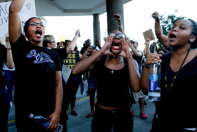 Protesters gather at 400 Stewart Ave. in downtown Las Vegas during a Black Lives Matter demonstration on Saturday evening, July 16, 2016. (Elizabeth Brumley/Las Vegas Review-Journal) Follow @Elipa ...
