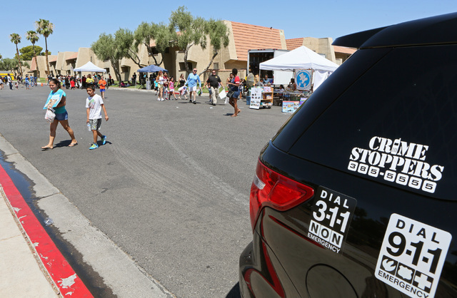 A neighborhood block party takes place on Viking Road near Wynn Road on Saturday, July 23, 2016, in Las Vegas. Metropolitan Police Department Enterprise Area Command hosted the family-friendly eve ...
