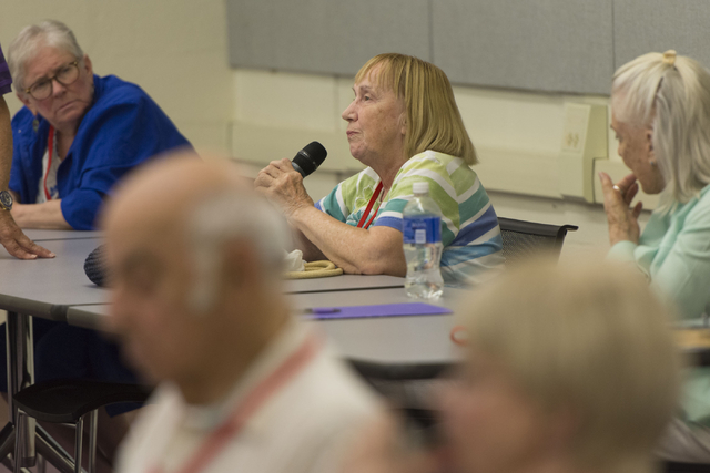 Marilynne Recker, center, directs a question to instructor Howie Sussman after watching a documentary film during the Osher Lifelong Learning Institute class on Winston Churchill at UNLV's Educati ...