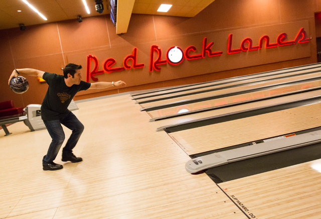 Rolltech founder and CEO Rich Belsky  prepares to roll a bowling ball down a lane as the company runs tests for their bowling app and website at Red Rock Lanes in Red Rock Resort in Las Vegas on M ...