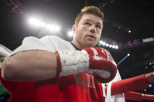 "Saul ""Canelo"" Alvarez makes his way to the ring his fight against Amir Khan in the WBC Middleweight Title bout at the T-Mobile Arena on Saturday, May 7, 2016, in Las Vegas. Alvarez w ..."