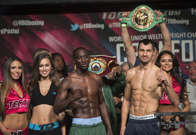 Boxers Terence Crawford, third from left, and Viktor Postol pose ahead of their Junior Welterweight title fight during the weigh-in event at the MGM Grand Garden Arena in Las Vegas on Friday, July ...