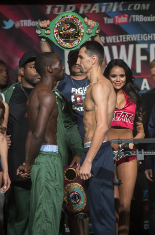Boxers Terence Crawford, left, and Viktor Postol pose ahead of their Junior Welterweight title fight during the weigh-in event at the MGM Grand Garden Arena in Las Vegas on Friday, July 22, 2016.  ...
