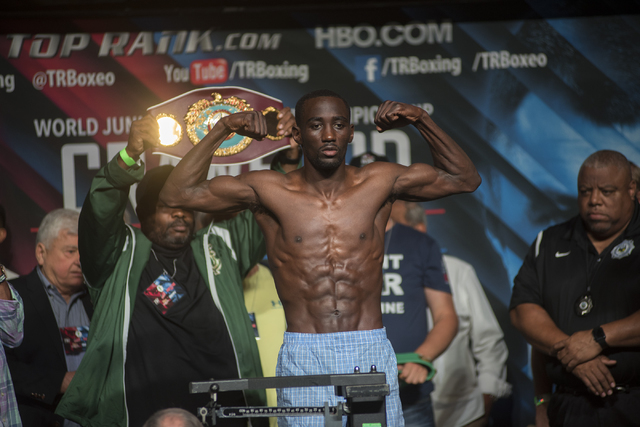 Boxer Terence Crawford is seen weighing-in ahead of his Junior Welterweight title fight against Viktor Postol at the MGM Grand Garden Arena in Las Vegas on Friday, July 22, 2016. (Martin S. Fuente ...