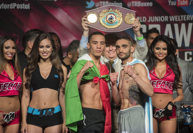 Boxers Oscar Valdez Jr., center left, and Matias Rueda pose ahead of their Featherweight title fight during the weigh-in event at the MGM Grand Garden Arena in Las Vegas on Friday, July 22, 2016.  ...