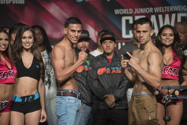 Boxers Jose Benavidez, center left, and Francisco Santana pose ahead of their welterweight fight during the weigh-in event at the MGM Grand Garden Arena in Las Vegas on Friday, July 22, 2016. (Mar ...