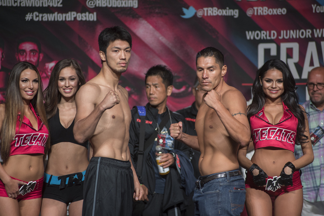 Boxers Ryoto Murata, center left, and George Tahdooahnippah pose ahead of their middleweight fight during the weigh-in event at the MGM Grand Garden Arena in Las Vegas on Friday, July 22, 2016. (M ...