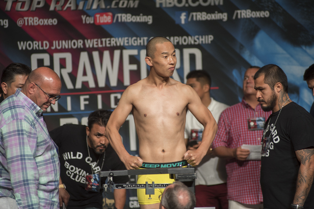 Boxer Lianhui Yang is seen weighing-in ahead of his super lightweight fight against Lenny Zappavigna at the MGM Grand Garden Arena in Las Vegas on Friday, July 22, 2016. (Martin S. Fuentes/Las Veg ...