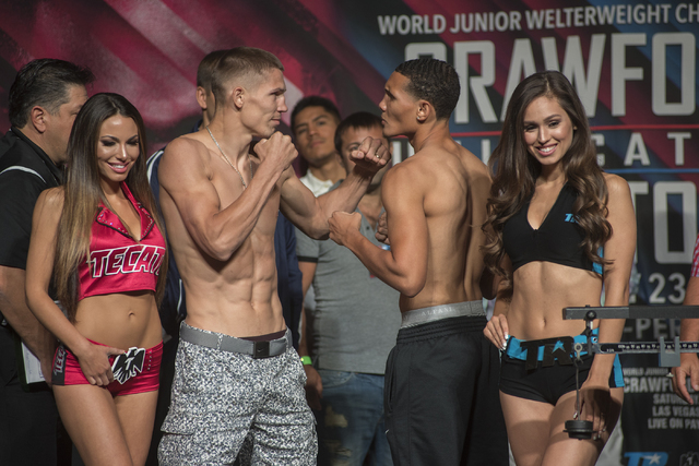Boxers Stanislav Skorokhod, center left, and Hakim Bryant pose ahead of their middleweight fight during the weigh-in event at the MGM Grand Garden Arena in Las Vegas on Friday, July 22, 2016. (Mar ...