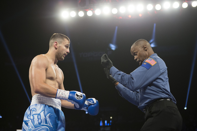 Oleksandr Gvozdyk gets a count after taking a knee against Tommy Karpency in the light heavyweight NABF Championship bout at the MGM Grand Garden Arena on Saturday, July 23, 2016, in Las Vegas.(Er ...