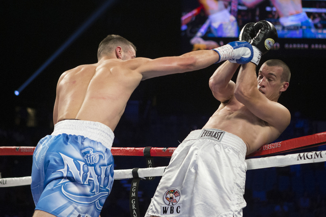 Oleksandr Gvozdyk, left, battles Tommy Karpency in the light heavyweight NABF Championship bout at the MGM Grand Garden Arena on Saturday, July 23, 2016, in Las Vegas. (Erik Verduzco/Las Vegas Rev ...