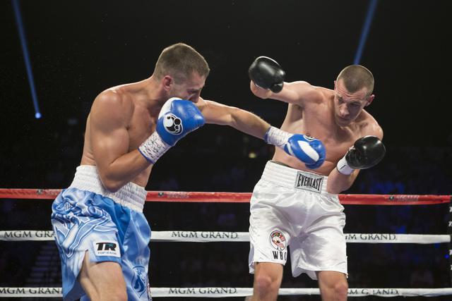 Oleksandr Gvozdyk, left, battles Tommy Karpency in the light heavyweight NABF Championship bout at the MGM Grand Garden Arena on Saturday, July 23, 2016, in Las Vegas.(Erik Verduzco/Las Vegas Revi ...