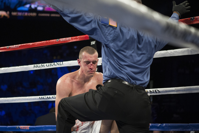 Tommy Karpency takes a knee to lose by technical knockout against Oleksandr Gvozdyk in the sixth round of the light heavyweight NABF Championship boutat the MGM Grand Garden Arena on Saturday, Jul ...