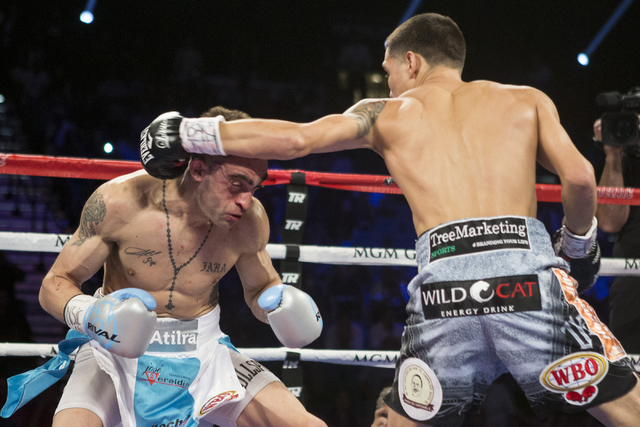 Oscar Valdez Jr., right, throws a left punch against Matias Rueda in the featherweight title bout for the vacant WBO World Title at the MGM Grand Garden Arena on Saturday, July 23, 2016, in Las Ve ...